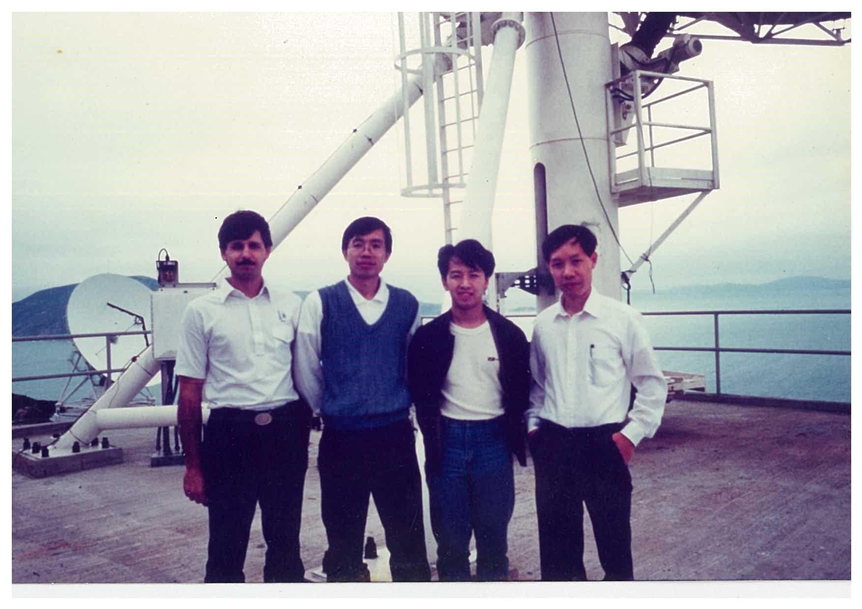 William (second from right) with colleagues and representatives from Telesat and Lockheed Martin at AsiaSat Stanley Earth Station in Hong Kong to provide AsiaSat's first time satellite tracking service in 1990 using AsiaSat's TT&C antenna and RF equipment