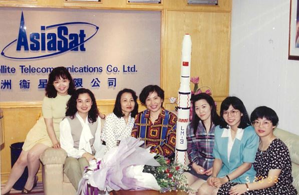 Betty (second from right) with the ladies team at the reception of AsiaSat's very first Causeway Bay office in East Exchange Tower Hong Kong