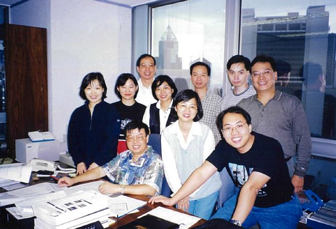 Betty (1st row standing, third from left) with her former boss, head of the Finance team Denis Lau, AsiaSat's very first employee