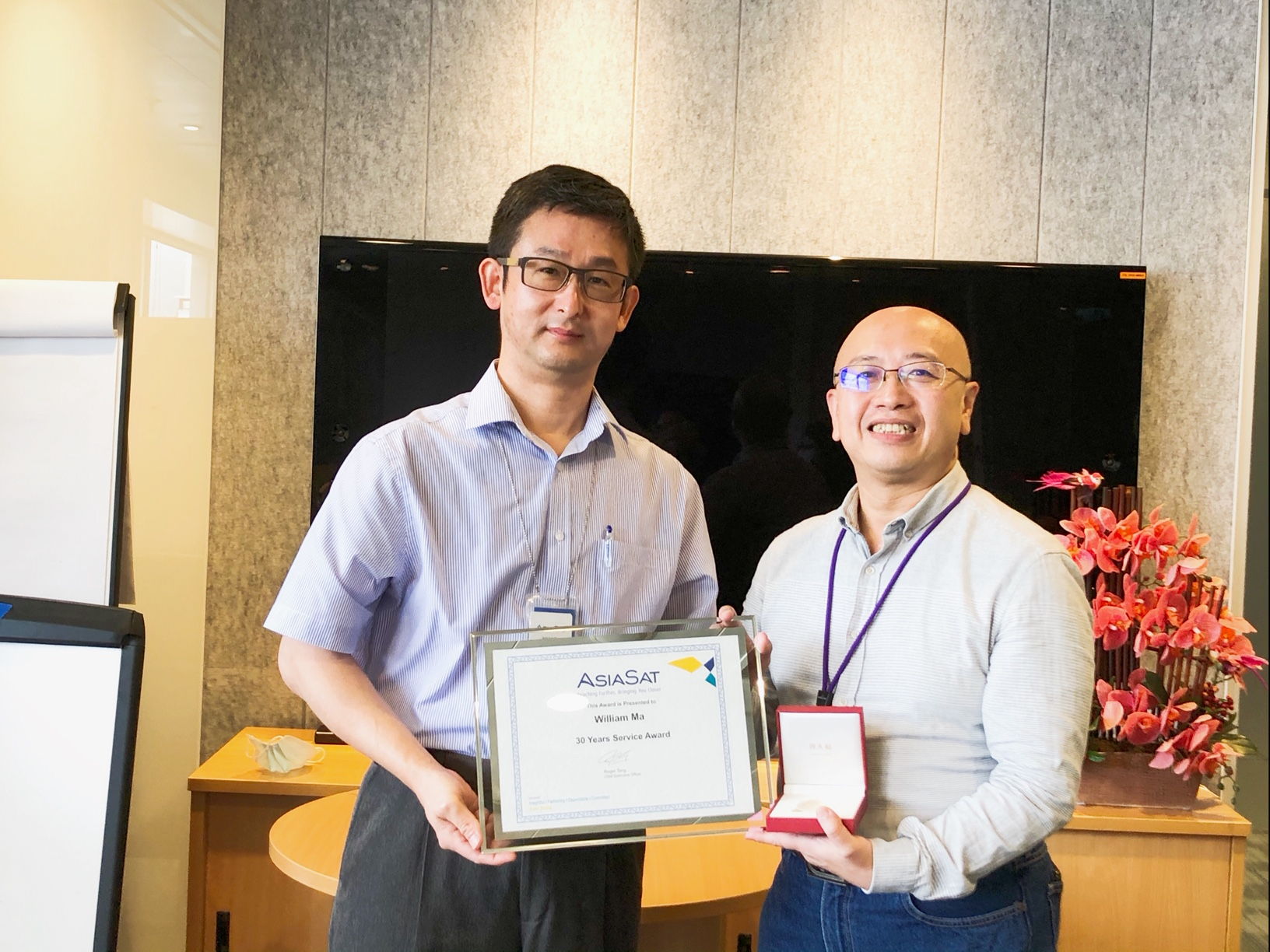 William receiving his 30 Years Service Award from CEO Roger Tong