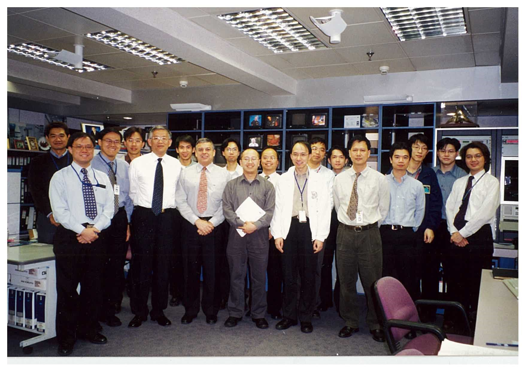 William (front row, third from right) pictured with the AsiaSat Operations Team on the day of deorbiting AsiaSat 1 in 2003 after its 13 years of service to Asia