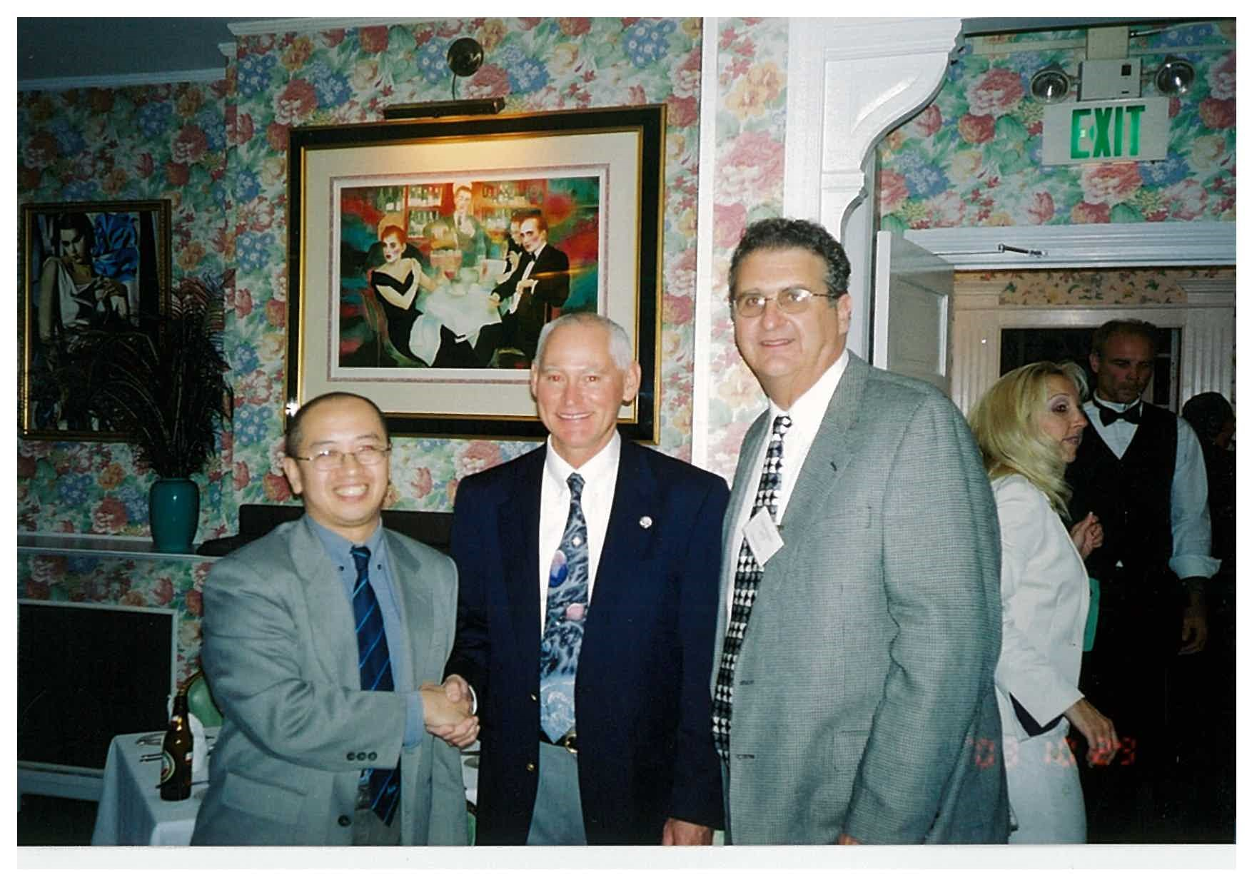 William (left) meeting Astronaut Michael Mullane (middle) in Lockheed Martin Users' Conference in 2003