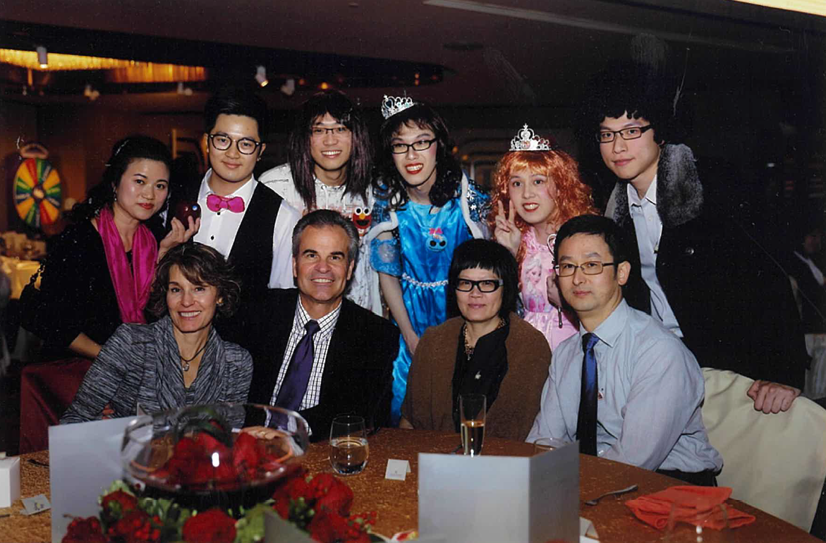 Janus undertaking the roles of screen writer, make up, prop and costume director at a performance given by student interns at the 2009 annual dinner. Seated on front row from left to right: Mr. & Mrs. William Wade and Mr. and Mrs. Roger Tong