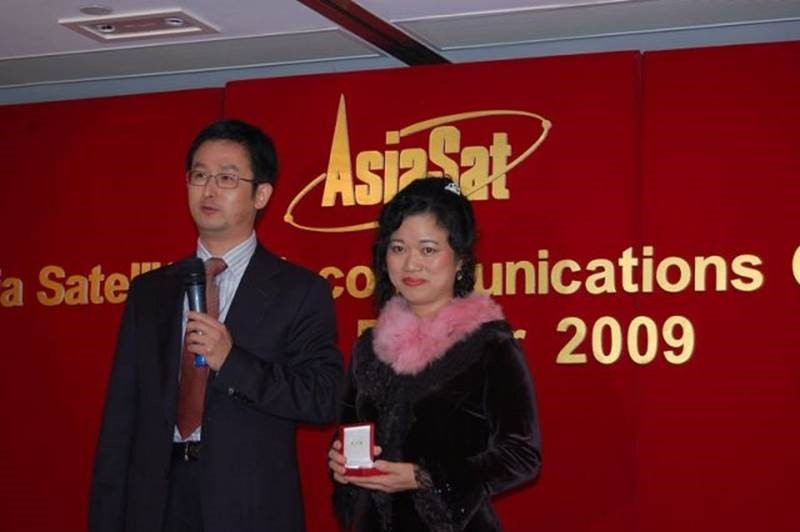 Janus receiving her 20 Years Service Award from Roger Tong, Head of Engineering during 2009