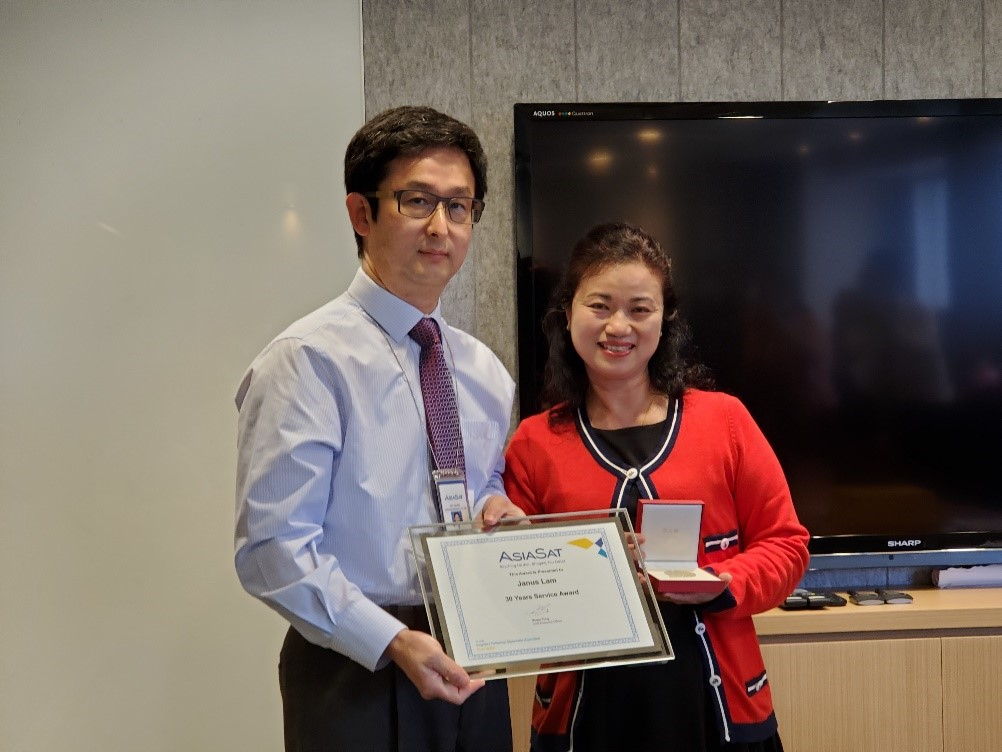 Janus was excited to receive her 30 Years Service Award, the second long service award presented by her boss Roger Tong, AsiaSat's CEO