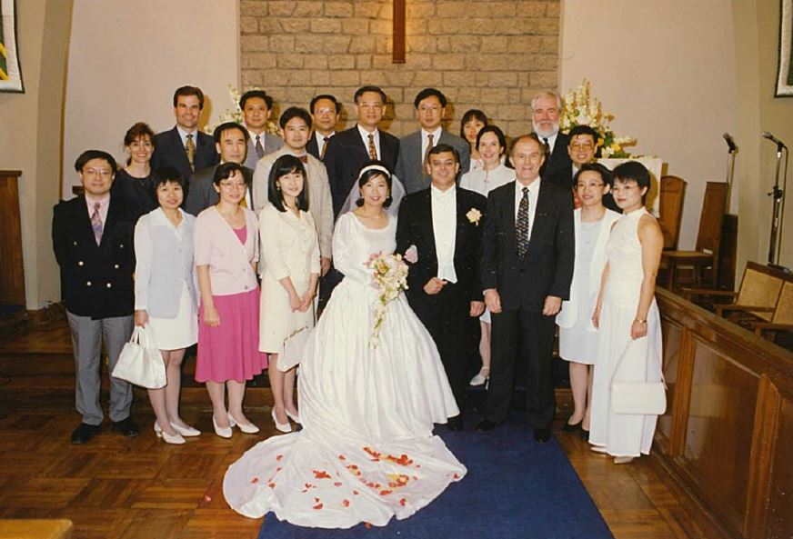 Fred (first row, first from left) attending former CEO Peter Jackson's wedding ceremony