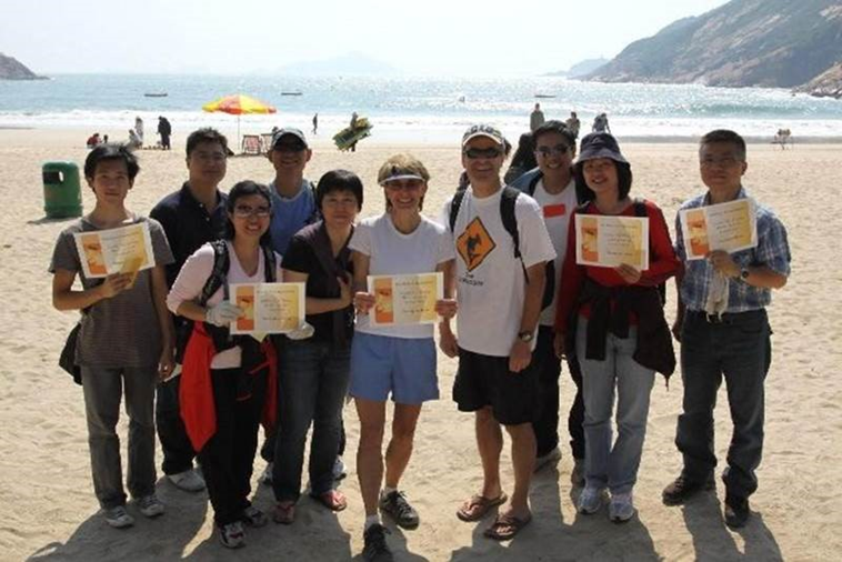 Janus (front row, second from left) and her team won the beach cleaning competition - a great encouragement and reward after a good day's work under the lovely sun