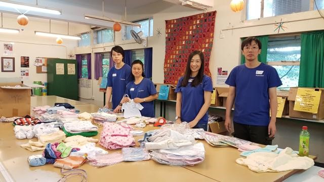 Janus (second from left) at Crossroads Foundation sorting donated goods, without wasting resources and helping the environment and the communities