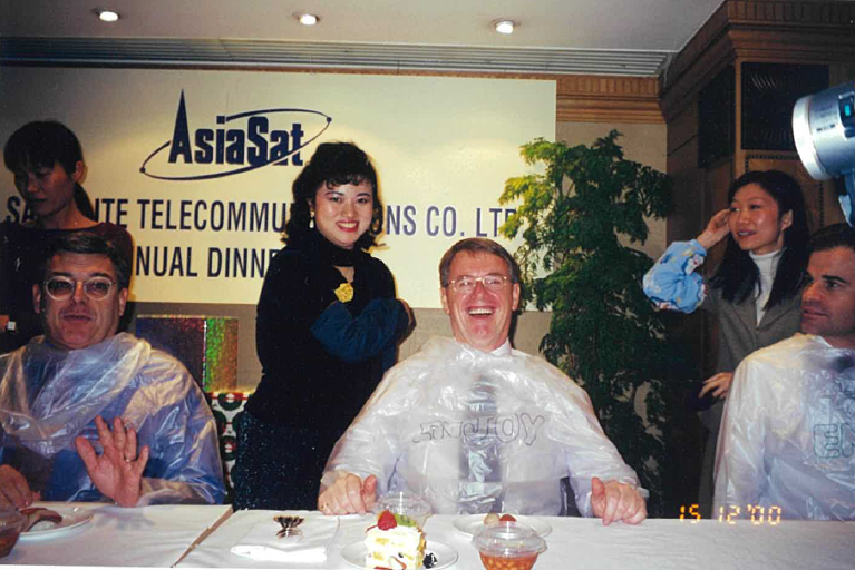 Janus and her former boss (middle) were having fun at the inter-department game during the 2000 annual dinner. Seated from left to right: Peter Jackson, Barry Turner and William Wade - AsiaSat's former management team