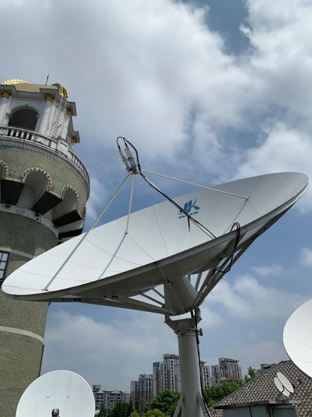 The 2.4m antenna installed with AsiaSat's bandpass filters to reject 5G interference