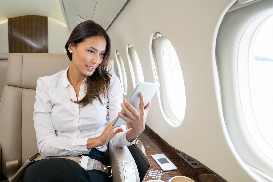 lady using pad and wifi on plane